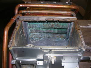 corroded evaporator coils in an HVAC unit